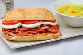 Antipasto Sandwich beside a bowl of soup
