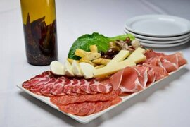 Antipasto Cold cuts and vegetables on plate