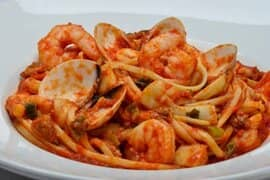 Seafood pasta dish with tomato sauce