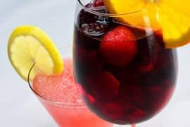 Sangria and cocktail with fruit inside of cup